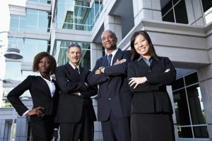 Team of multi-ethnic business people standing outside office building.